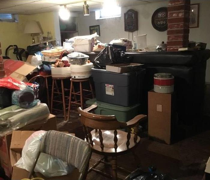 Basement rec room loaded with contents and mold
