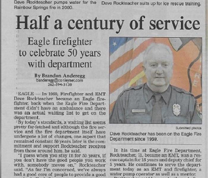 Cut out of newspaper article about local firefighter who has served for 50 years
