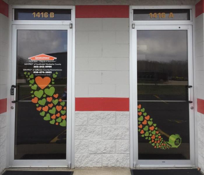 SERVPRO office doors decorated with paper hearts