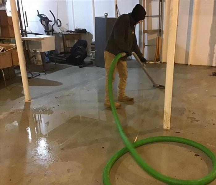 technician extracting water from basement