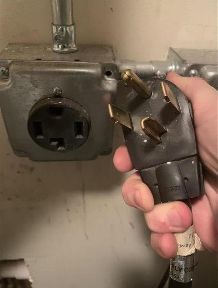 Photo of a dryer outlet and plug