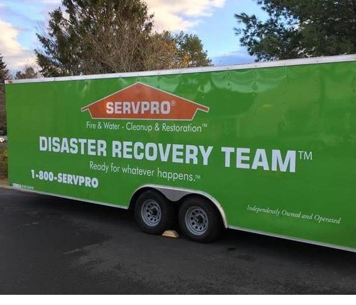 "Double Wide Green Box truck Trailer that reads "" Disaster Recovery Team"""